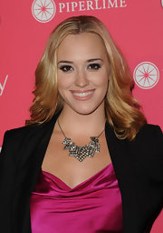 Andrea Bowen accented her shimmering neckline with a diamond encrusted collar necklace.
