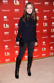 The actress looked chic in a cute cold weather ensemble with black leather knee high boots. These classic shoes are the perfect fall footwear.