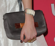 Whitney attended the Hot Hollywood party wearing a rhinestone encrusted link bracelet.