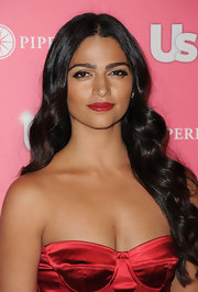 Camila Alves added some spice to her satin corset dress with ravishing red lipstick.