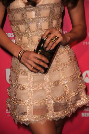 Jennifer carried a metallic gold hard case clutch which complemented her handful of gold accessories.