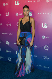 Adriana Lima paired her sexy top with a colorful Gabriela Cadena maxi skirt.