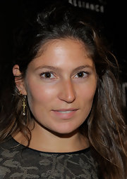 Stella Schnabel wore a dangling cross earrings at the 'Miral' party.