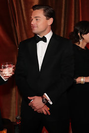 Leonardo DiCaprio complemented his elegant tux with a sporty leather-band chronograph watch during the 2013 Golden Globes after-party.