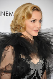Madonna wore her long locks pinned up into a faux bob at a screening of 'W.E.'