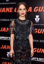 Natalie Portman paired a black Dior satin clutch with a Valentino beaded dress for the New York premiere of 'Jane Got a Gun.'