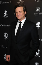Colin Firth attended the premiere of 'The King's Speech' wearing  a black peak lapel suit, white shirt and black tie.