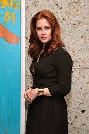 Amy Adams added shimmer to her dark outfit with thick gold cuff bracelets on both wrists during the 'Big Eyes' after-party.