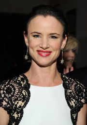 Juliette Lewis complemented her elegant dress with dangling diamond earrings by H. Stern for a flawless finish at the Weinstein Company's holiday party.