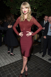 Taylor Swift cut a svelte silhouette in a maroon Herve L. Leroux dress during the Weinstein Company's holiday party.