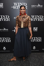 Rachel Roy teamed her jacket with a navy maxi skirt.