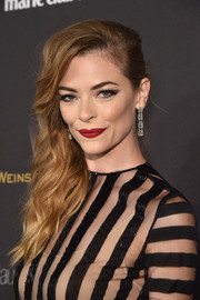 Jaime King swiped on some red lipstick for a pop of color to her neutral outfit.