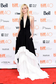 Elle Fanning unleashed her vampy side in a deep-V black-and-white halter gown by Emilio Pucci at the TIFF screening of 'About Ray.'