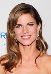 Natalie Morales paired her loose waves with decadent yellow and diamond drop earrings.