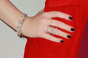 Michelle Trachtenberg added some sparkle to her look with a diamond swirl ring.