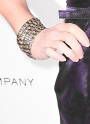 Kathy Griffin added a touch of sparkle to her purple satin dress with silver and diamond bangles.