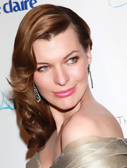 Milla Jovovich looked amazing at a Golden Globes after party. The model turned actress finished off her look with diamond earrings.