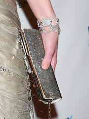 Milla opted for even more sparkle with not one but two diamond bracelets.