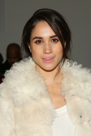 Meghan Markle was sexily coiffed with this messy updo at the Wes Gordon fashion show.