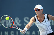 Samantha Stosur crushes the ball while wearing a very cool pair of shield-shaped sunglasses.