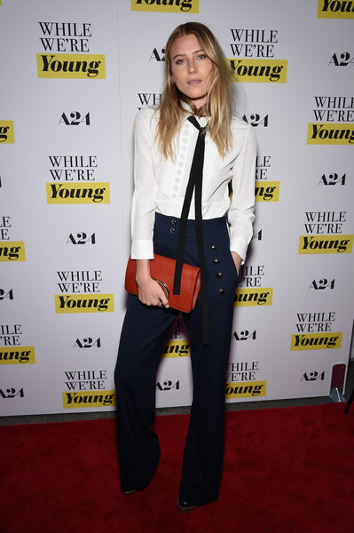 Dree Hemingway's red Chloe leather clutch provided a nice contrast to her navy trousers.