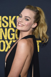 Margot Robbie contrasted her sizzling-hot outfit with a sweet and youthful ponytail when she attended the 'Whiskey Tango Foxtrot' world premiere.