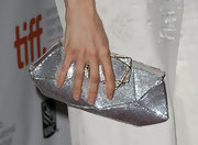 Rachel Weisz paired her winter white frock with a sparkling silver clutch.