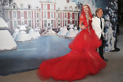 Natalia looked like a modern day fairy tale in a red tulle gown for her Naked Heart benefit.