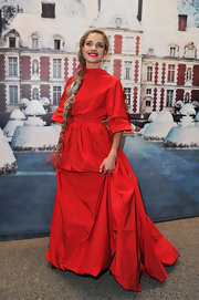 Natalia channels Little Red Riding Hood in a crisp taffeta gown for the 'White Fairy Tale Love Ball' benefit.