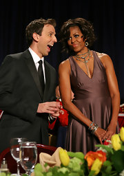 The First Lady stacked oxidized sterling silver bangles on her arm for the White House Correspondents' Dinner.