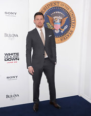 Channing looked sleek and contemporary in this charcoal-colored window pane checked suit.