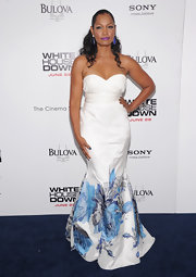 Garcelle Beauvais wore this flowing white strapless mermaid gown with blue flower detailing to the 'White House Down' premiere.