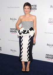 Maggie Gyllenhaal stunned in a strapless knit patterned dress featuring a ruffled peplum detail, which she wore to the 'White House Down' premiere.