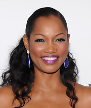Garcelle had some fun with her beauty look when she opted for a bright purple lipstick.