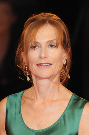 Isabelle Huppert amped up the glam factor with dangling diamond earrings and a lovely updo.