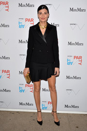 Giovanna Battaglia added some shine via a metallic gold hard-case clutch.