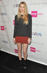 Whitney Port gave her sophisticated top a fresh vibe with an Aztec print skirt.