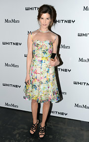 Hanneli Mustaparta matched her colorful frock with chic black strappy sandals.
