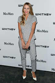 Harley Viera-Newton chose the print-on-print look with this black-and-white button down and matching pants.