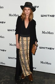 Erin Wasson looked totally boho chic with this maxi that had a chic printed skirt.