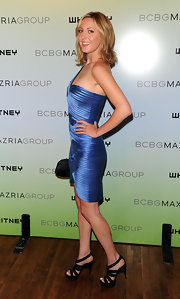 Eva wore strappy platform sandals with a bandage-style cocktail dress.