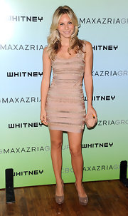 Joyce looked fabulous in a beaded blush mini dress with matching suede pumps and an Herve Leger clutch.