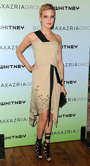 Maggie wore edgy gladiator sandals with a chic two-toned cocktail dress.