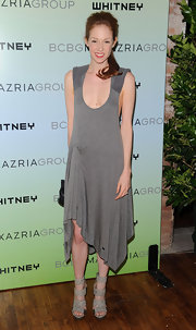 Stephanie wore a slinky gray dress with thick strappy sandals.