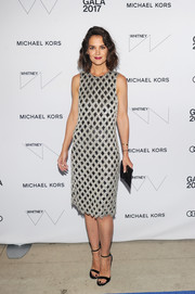 Katie Holmes paired her chic dress with simple black ankle-strap sandals, also by Michael Kors.