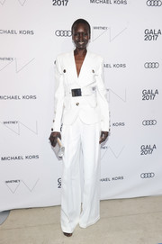 Alek Wek polished off her look with a metallic silver clutch.