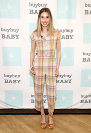 Whitney Port styled her jumpsuit with a pair of mustard velvet platforms.