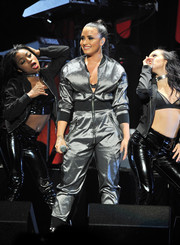 Demi Lovato was sporty-glam in a silver zip-front jumpsuit by Michael Ngo while performing at WiLD 94.9's Jingle Ball show.