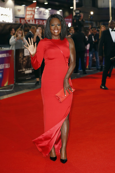 Viola Davis looked fashion-forward in a red one-sleeve column dress by Akris at the European premiere of 'Widows.'