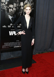 Elizabeth Debicki sheathed her statuesque figure in a fitted black Armani dress with a navel-grazing neckline for the special screening of 'Widows.'